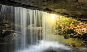 Sun shining through water fall